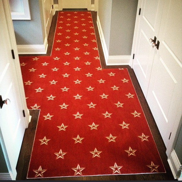 seeing-stars-carpet-installation-phase-2-red-carpet-in-hallway